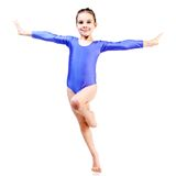 Young girl doing gymnastics. Little girl doing gymnastics isolated on white background Stock Photography