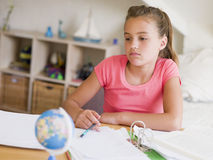 Young Girl Doing Her Homework Stock Photography