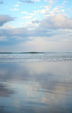 Beautiful beach, sky reflected in the water. Royalty Free Stock Photo