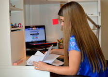 Young girl doing her homework. Stock Images