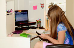 Young girl doing her homework. Royalty Free Stock Photography