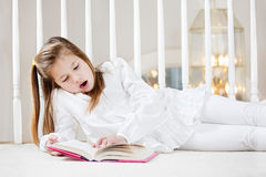 Young girl doing homework Stock Photography
