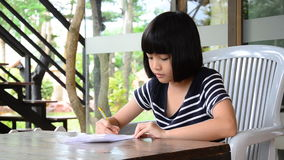 Young girl doing homework. stock video footage