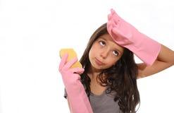 Young girl doing the housework Stock Photos
