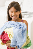Young Girl Doing Laundry Royalty Free Stock Photography