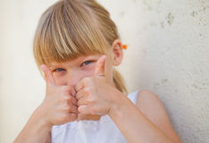 Young girl doing ok sign Stock Images