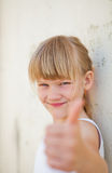 Young girl doing ok sign Stock Photography