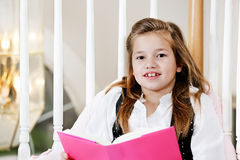 Young girl doing reading homework Royalty Free Stock Image