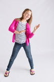 Young girl doing the robot dance. Cute pre-teen dancing the robot while smiling Stock Images