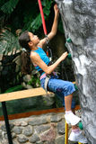 Young girl doing rock climbing Royalty Free Stock Photography