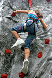 Young girl doing rock climbing Stock Photography