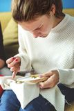Young girl doing some needlework royalty free stock images