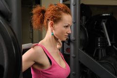 Young girl doing squats with barbell Stock Photos