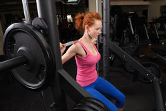 Young girl doing squats with barbell Royalty Free Stock Images