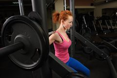 Young girl doing squats with barbell Royalty Free Stock Photography