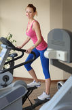 Young girl doing step machine workout Royalty Free Stock Image