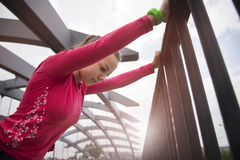 Young girl doing stretching exercises on the bridge Stock Photos