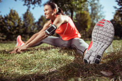 Young girl doing stretching on her morning outdoors training Royalty Free Stock Image