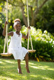 Young girl doing swing Royalty Free Stock Image