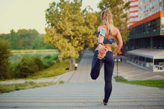 Young girl doing warm-up in  park on summer autumn nature. Royalty Free Stock Photography