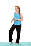Young girl doing workout Stock Photo