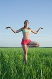 Young girl doing yoga against nature Royalty Free Stock Images