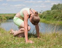 Young girl doing yoga against nature Royalty Free Stock Image