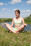 Young girl doing yoga against nature Stock Image