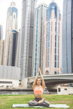 Young girl doing yoga against skyscrapers Royalty Free Stock Images