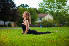 Young girl doing yoga exercise alone Stock Image