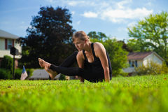 Young girl doing yoga exercise alone Stock Images