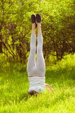 Young girl doing yoga on a green grass Royalty Free Stock Photos