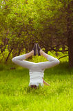 Young girl doing yoga on a green grass Stock Photography