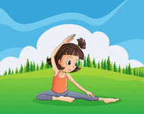 A young girl doing yoga at the hilltop Stock Photo