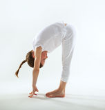 Young girl doing yoga Royalty Free Stock Photos