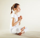 Young girl doing yoga Royalty Free Stock Images