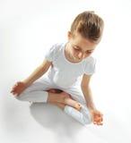 Young girl doing yoga Stock Photos