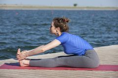 Free Young Girl Doing Yoga Or Fitness Exercise Outdoor In Nature With Beautiful Lake. Meditation And Relax Concept Royalty Free Stock Photo - 150684385