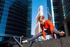 Young girl doing yoga outdoors in city Stock Photos