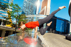 Young girl doing yoga outdoors in city Stock Images