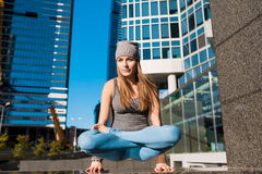 Young girl doing yoga outdoors in city Royalty Free Stock Photography