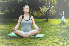 Young girl doing yoga in the park Stock Image