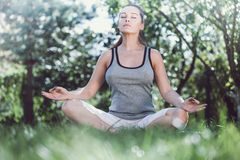 Young girl doing yoga in the park Royalty Free Stock Image