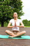 Young girl doing yoga in the park with closed eyes Royalty Free Stock Photo