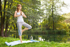 Young girl doing yoga in the park Royalty Free Stock Images