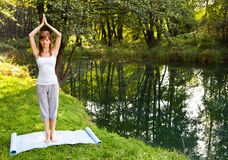 Young girl doing yoga in the park Royalty Free Stock Photo