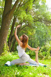 Young girl doing yoga in the park Stock Photos