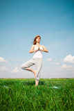 Young girl doing yoga in the park Stock Photography