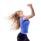 Young girl doing zumba fitness. Aerobics fitness female dancing with disheveled hair and arms raised. Happy cheerful woman enjoying zumba dance. Isolated on Stock Photos