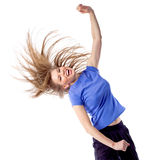 Young girl doing zumba fitness. Aerobics fitness woman training active in studio, isolated on white. Smiling young female with disheveled hair and hand raised Royalty Free Stock Photography